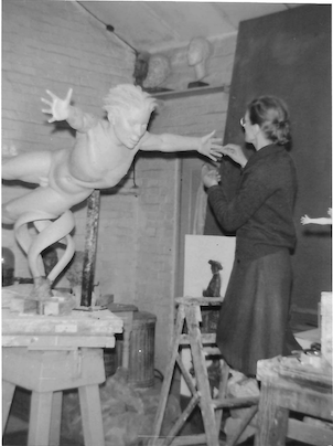 Rose Gwynneth Holt FRBS (1909-1995) working on West Wind in her studio